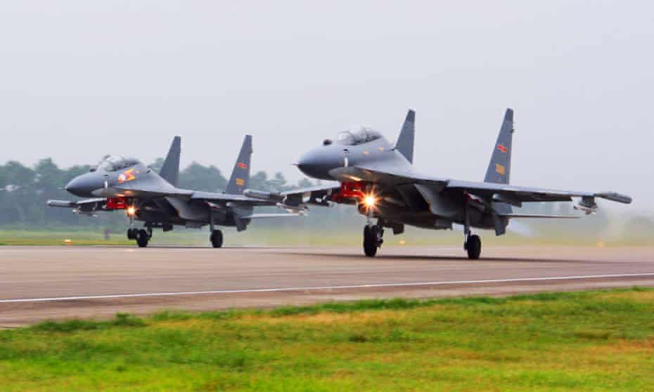 Two Chinese SU-30 fighter jets take off to fly a patrol over the South China Sea.