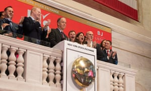 Cunningham and executives from BJ's ring the exchange's bell to announce the wholesale retailer's share sale