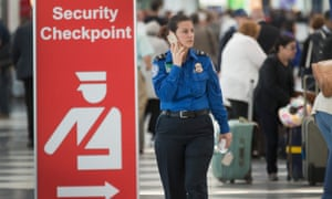Security staff member at Chicago O'Hare airport.