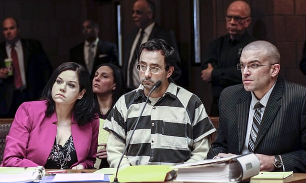 Dr Larry Nasser and his attorneys at a hearing in Lansing on Friday.