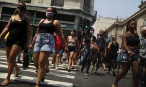 People walk around the Saara street market, amid the outbreak of the coronavirus disease, in Rio de Janeiro, Brazil.