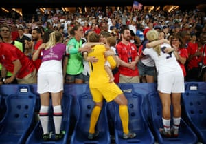 USA players celebrate with their family following their victory in the quarter final match between France and USA at Parc des Princes.