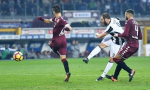 Gonzalo Higuaín scores his second goal for Juventus in the Turin derby against Torino.