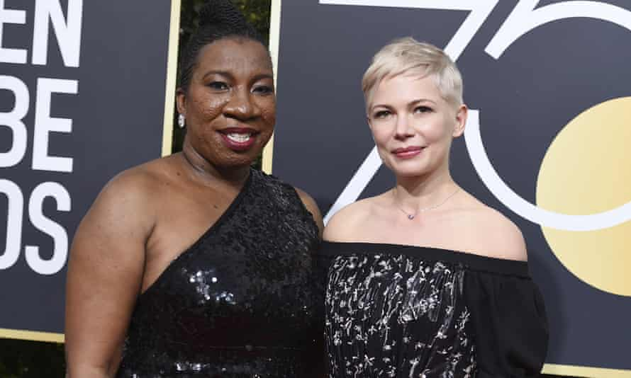 Tarana Burke, left, and Michelle Williams at the Golden Globes in January.