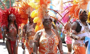 Masquerade dancers take part in the parade