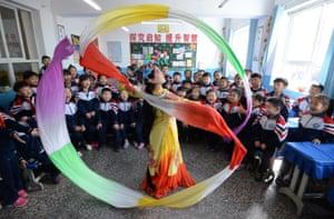 Students celebrating World Drama Day in Hebei province, China