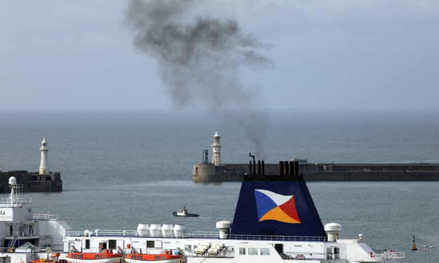 Smoke rises from a ferry at Dover, UK.