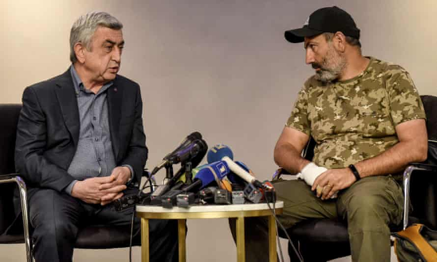 The new Armenian PM Serzh Sarksyan, left, debates Nikol Pashinyan in a televised encounter, shortly before Sarksyan, an opposition leader, was detained.