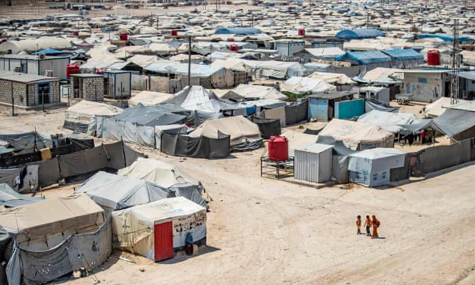 Children walking among shelters at al-Hol camp in north-eastern Syria