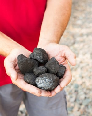 Gerren Anderson holds coal extracted from the land in the North Fork Valley.