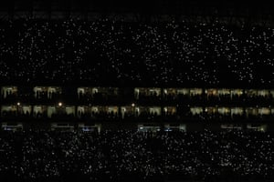 Monterrey, Mexico: Fans light their mobile phones in the stands prior to the CONCACAF Champions League final soccer match between Monterrey and Tigres
