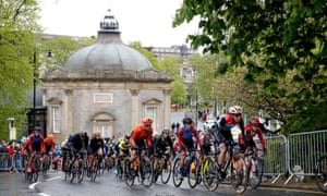 Riders pass the historic Royal Pump Room on the circuit at Harrogate that will be used in the upcoming UCI World Championships.