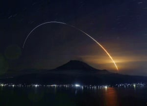 A light trail left by a H2B space rocket glows over Mount Sakurajima in Kagoshima, Japan