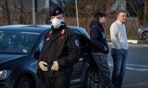 An Italian carabinieri blocks a road in Casalpusterlengo area, northern Italy