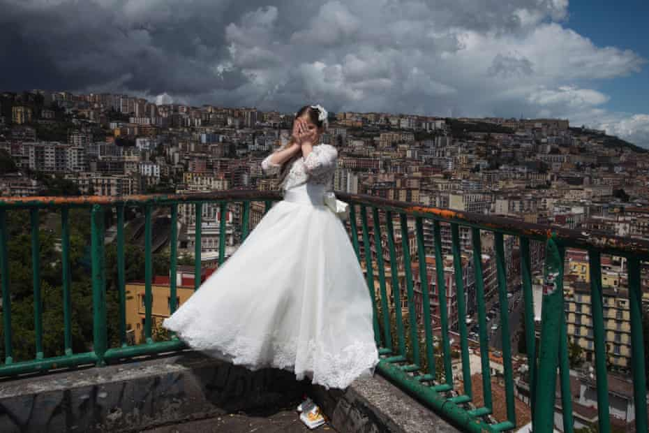 Maria takes a minute to herself during a photo shoot before her first communion party