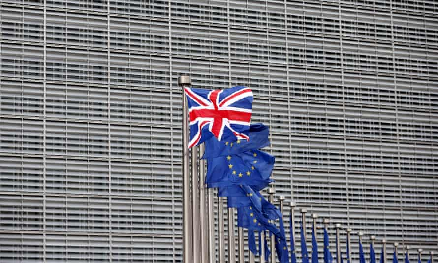 A union jack flutters beside EU flags at the EU headquarters in Brussels, ahead of a visit from Britain's then prime minister David Cameron in 2016.