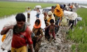 Rohingya Muslims fleeing military operations in Myanmar's Rakhine state make their way to Bangladesh.