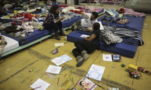 People who lost their homes in the 7.1 magnitude earthquake rest inside a gymnasium turned in an evacuation center in Mexico City