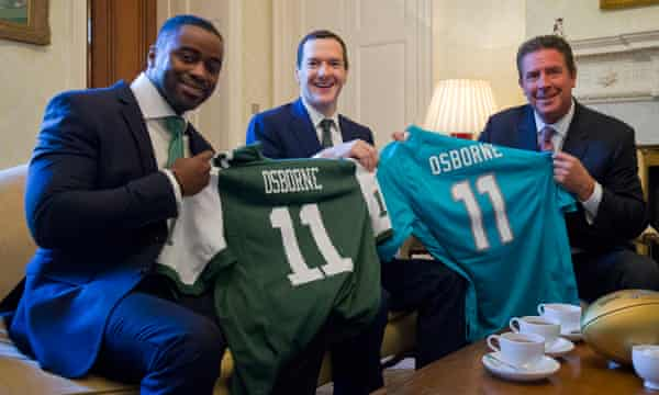 George Osborne with former NFL players Dan Marino, right, and Curtis Martin.