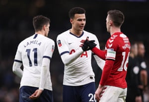 Dele Alli shakes hands with Jonny Howson at full time.