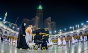 Saudis and foreign residents circumambulating the Kaaba (Tawaf) in the Grand Mosque complex in the holy city of Mecca, after authorities partially resume the year-round Umrah for a limited number of pilgrims amid extensive health precautions after a seven-month coronavirus hiatus, in October 2020.