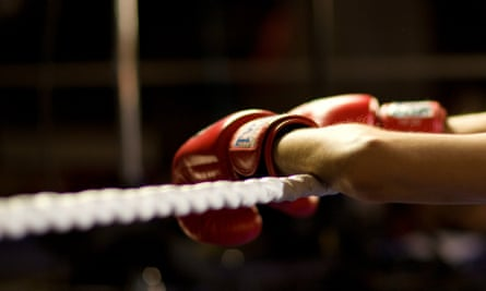 Close-up of boxer leaning on ropes