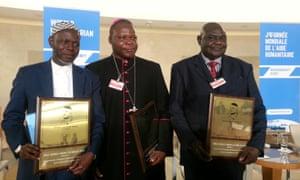 Sergio Vieira de Mello prize winners Imam Oumar Kobine Layama, Archbishop Dieudonné Nzapalainga and Pastor Nicolas Guérékoyaméné-Gbangou receive their award in Geneva.