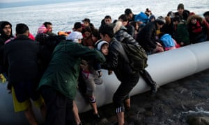Migrants from Afghanistan arrive on a beach near the village of Skala Sikamias on the island of Lesbos.