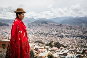 Bertha Acarapi looks out over the Bolivian capital, La Paz, from the backyard of ATB Television studios in the adjacent city of El Alto