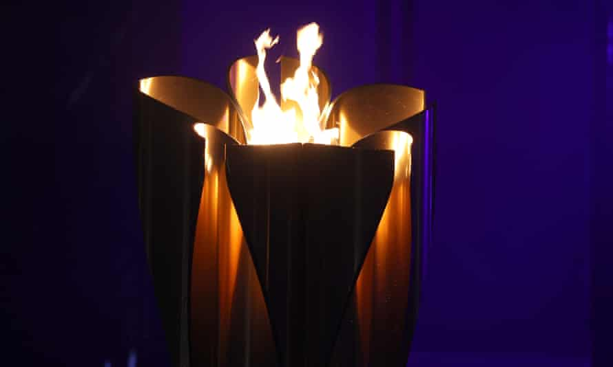 The Olympic flame is displayed on a cauldron at a Tokyo 2020 Olympics torch relay event in Yokohama.