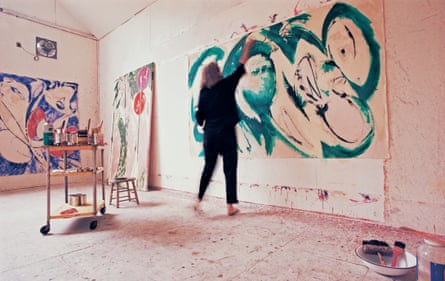 Lee Krasner, who died in 1984, at work in her studio in the 60s, painting Portrait in Green.