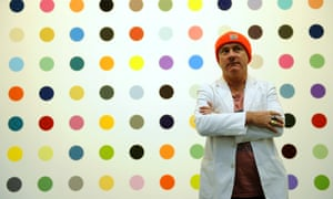 Damien Hirst in 2012 standing in front of one of his paintings at the Gagosian Gallery in New York.