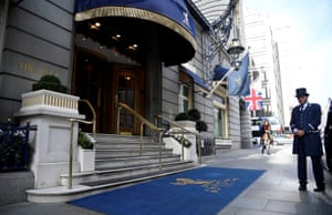 A doorman stands at an entrance to The Ritz London hotel in Piccadilly, London, today