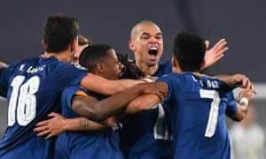 Pepe and his Porto teammates celebrate a remarkable victory.