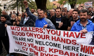 Protesters with 'Nato killers' sign