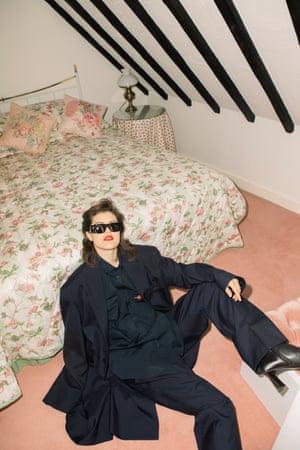 Power shoulders: jacket, shirt, trousers, boots, sunglasses by Balenciaga