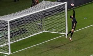 Courtois fingertips Neymar's shot over the bar.