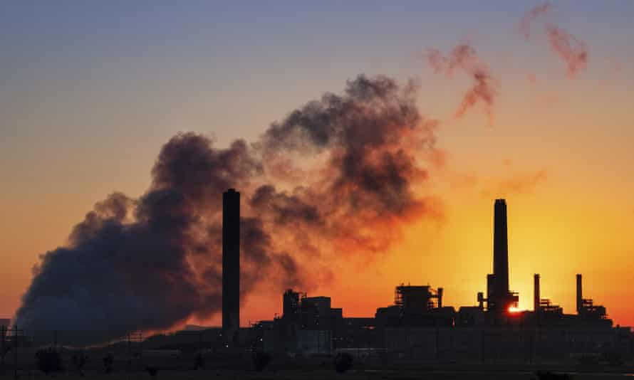 FILE - In this July 27, 2018, file photo, the Dave Johnson coal-fired power plant is silhouetted against the morning sun in Glenrock, Wyo. Jeremy Grantham, a British billionaire investor who's a major contributor to environmental causes, will fund carbon-capture research in Wyoming, the top U.S. coal-mining state. Wyoming's Republican governor, Mark Gordon, and the carbon-capture technology nonprofit Carbontech Labs announced Thursday, March 28, 2019, they're providing $1.25 million to help researchers find ways to turn greenhouse-gas emissions into valuable products. (AP Photo/J. David Ake, File)