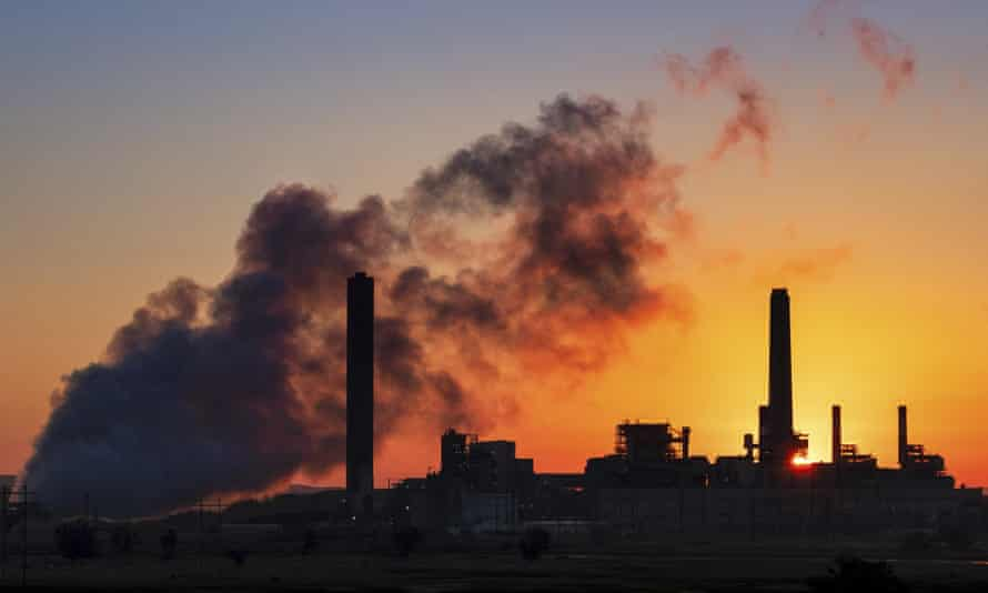 A coal-fired plant at sunset