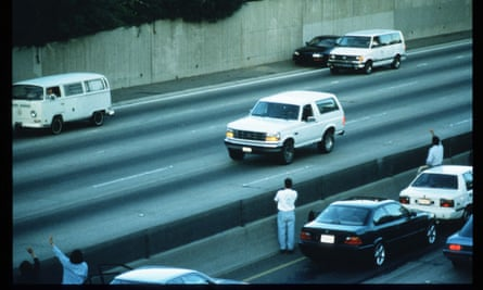 The Ford Bronco carrying OJ Simpson, pursued by police officers in a slow-speed freeway chase that ended with Simpson's arrest.