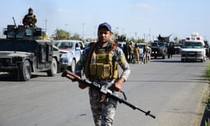 Iraqi forces take up position near Tikrit during operations to retake the city from Isis last year.