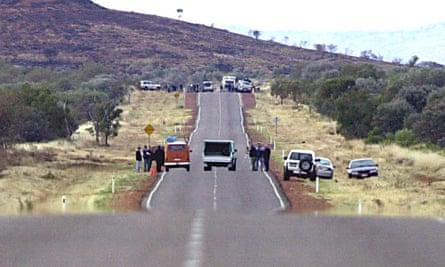 Police recreate the scene at the site of the ambush