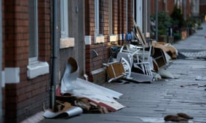 Residents empty possessions from their homes in Carlisle after flooding created by Storm Desmond.