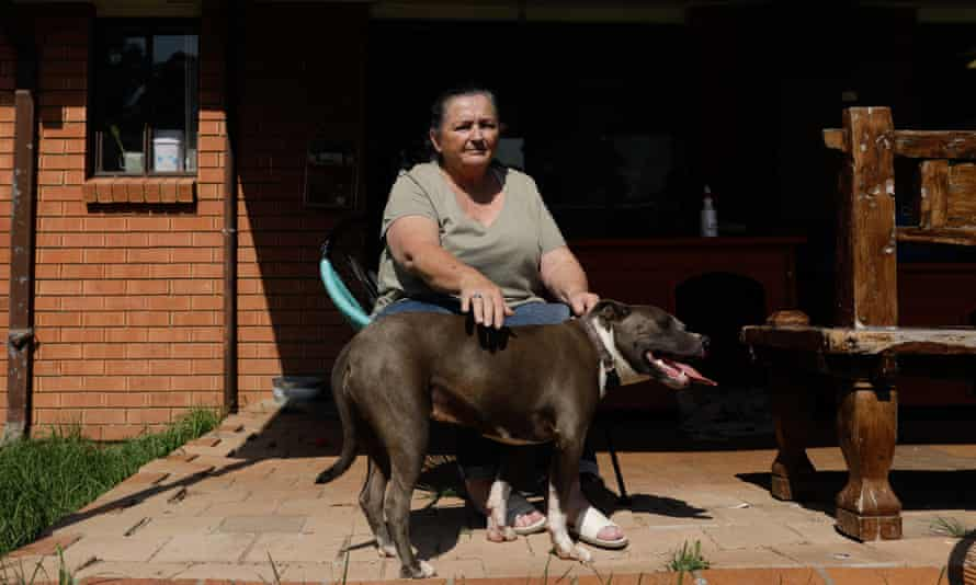 Angela Cadwallen with her dog outside her home