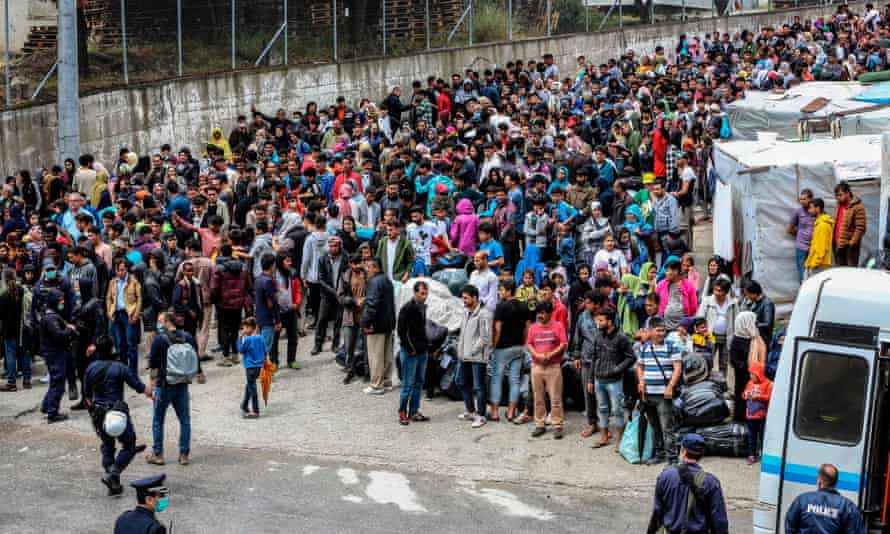 Refugees and migrants wait to be transferred from Lesbos to the Greek mainland.
