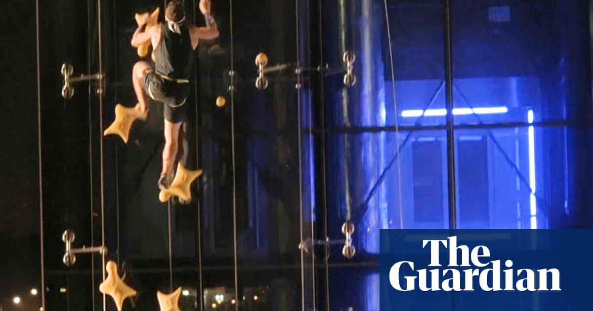 Speed climber takes on lift in six-storey sprint ... and wins – video