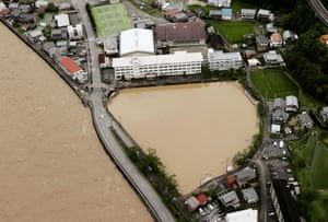 Grounds of a junior high school flooded following heavy rains in Gero, in Gifu prefecture