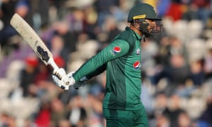Pakistan's Imad Wasim leaves the pitch after he is caught by England's Jos Buttler off the bowling of England's David Willey.