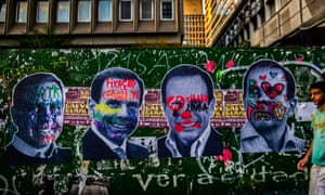João Doria images graffitied in protest on Paulista Avenue.