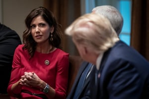 Kristi Noem with Donald Trump at the White House in December.